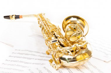 Alto saxophone on musical notes