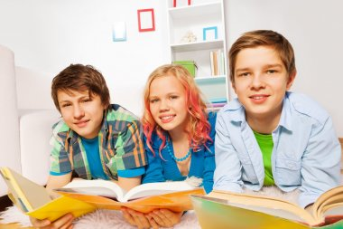 Happy young teens read books