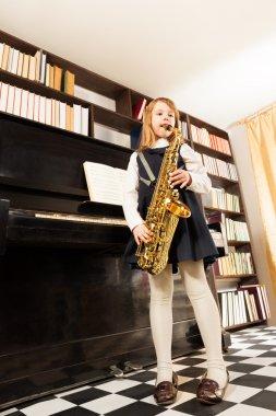 Girl plays alto saxophone