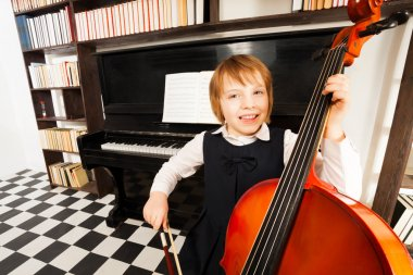 Happy kid playing cello