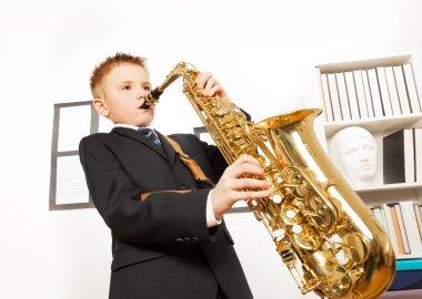 Boy playing alto saxophone