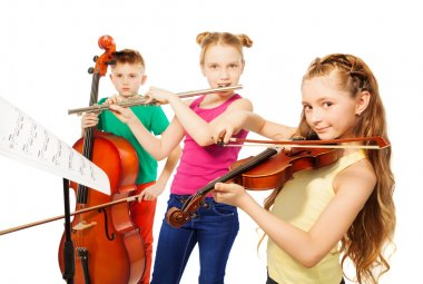 girls and boy playing musical instruments