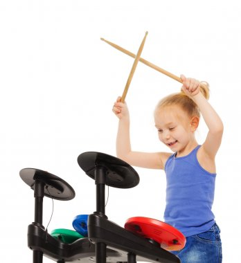 Happy blond girl plays cymbals