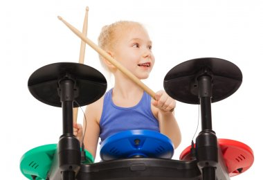 small girl playing on cymbals