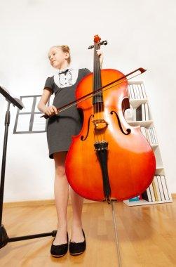 girl playing violoncello