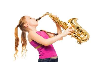 Happy girl playing saxophone
