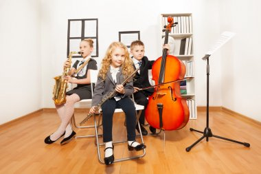 Happy kids playing musical instruments