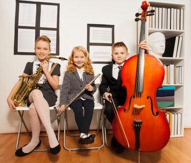 group of kids playing musical instruments