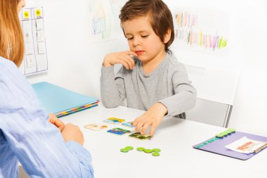 Preschooler boy plays in developing game