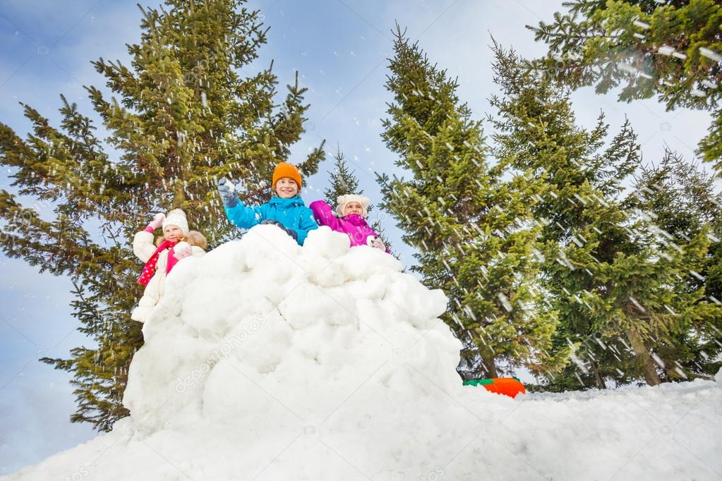 Children playing snowball fight game