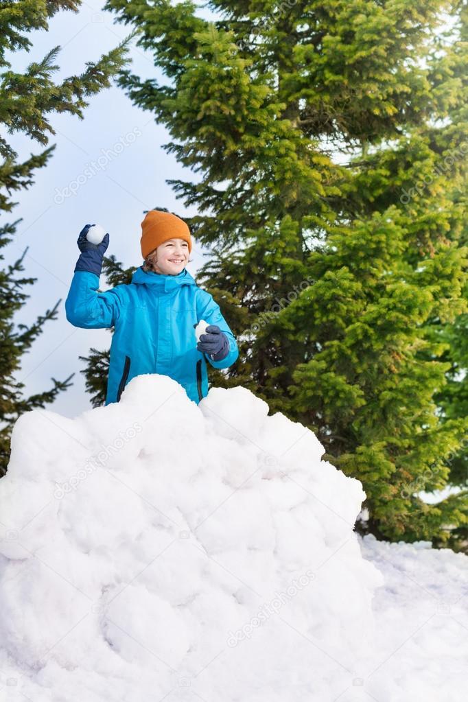 Boy throwing snowballs