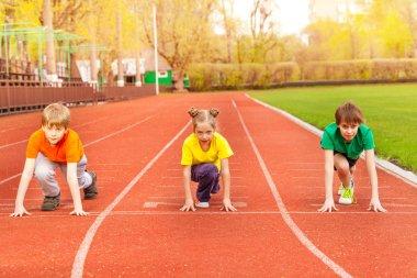 Three kids ready to run