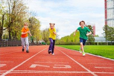 Children running marathon on finish line