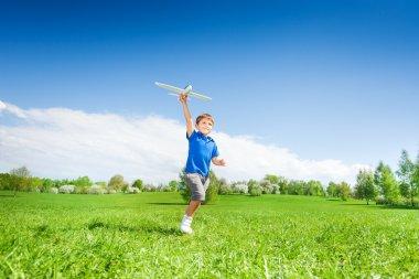 Happy boy holding airplane toy
