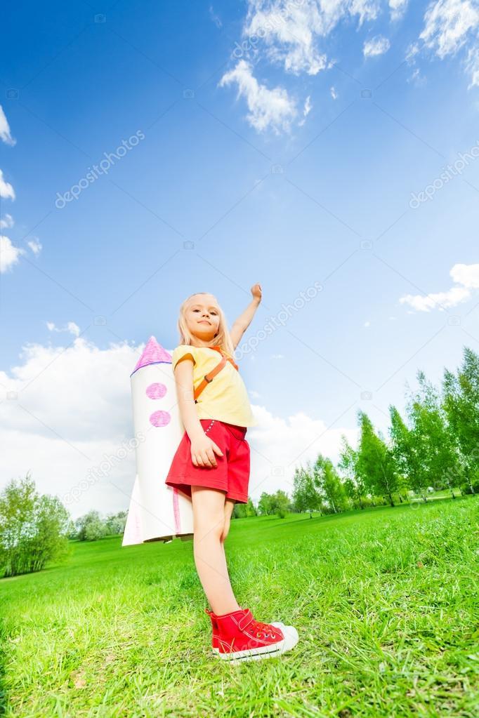 Girl wearing rocket toy