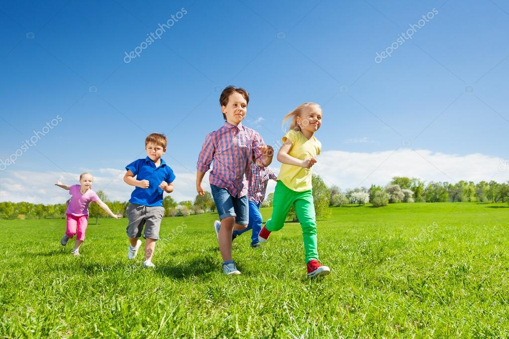 Happy group of children running