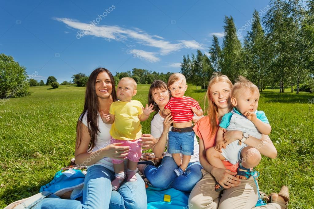 happy mothers with cute babies