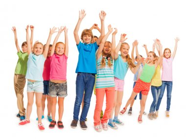 Group of happy kids with raised hands on white