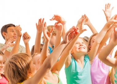 Happy kids with lifted hands in the air