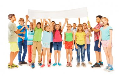 bunch of kids standing with white blank banner