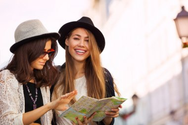 women with city map as tourists