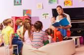 Fotografie Nurse in kindergarten read book