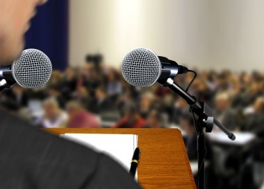 Speaker giving a speech during presentation