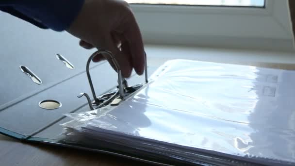 Putting a document in a holder
