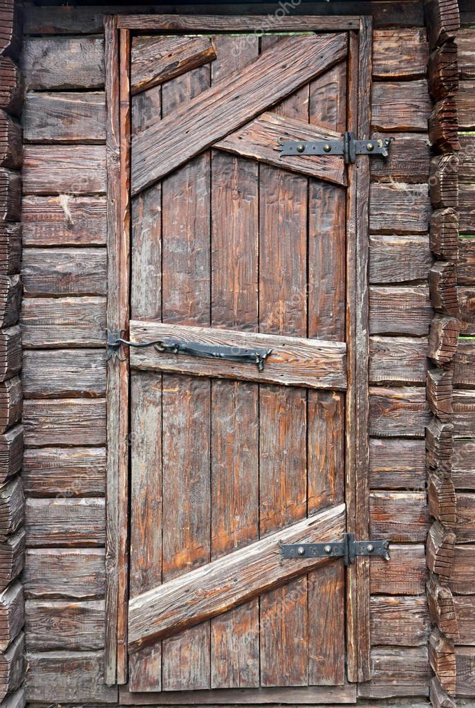Stylized antique wooden door — Stock Photo © DrTrIg #91284814