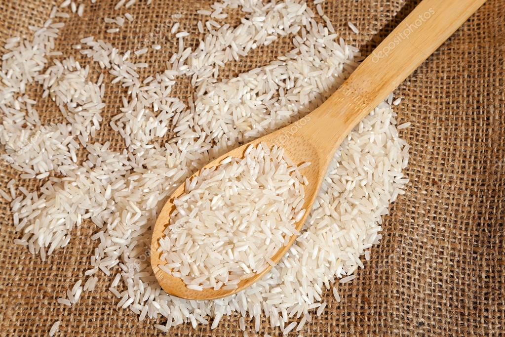rice grains on a wooden spoon