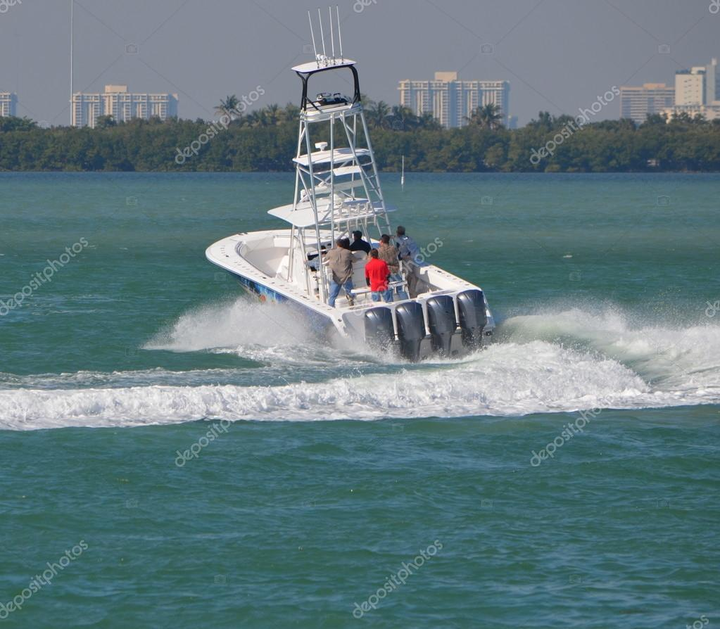 Fishing boat making a sharp left hand turn at high speed on the florida intracoastal waterway.