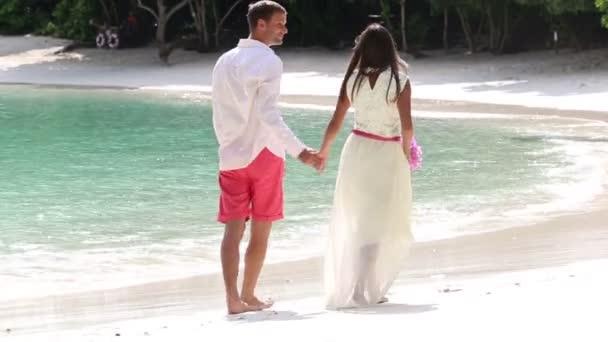 Happy groom and beautiful bride
