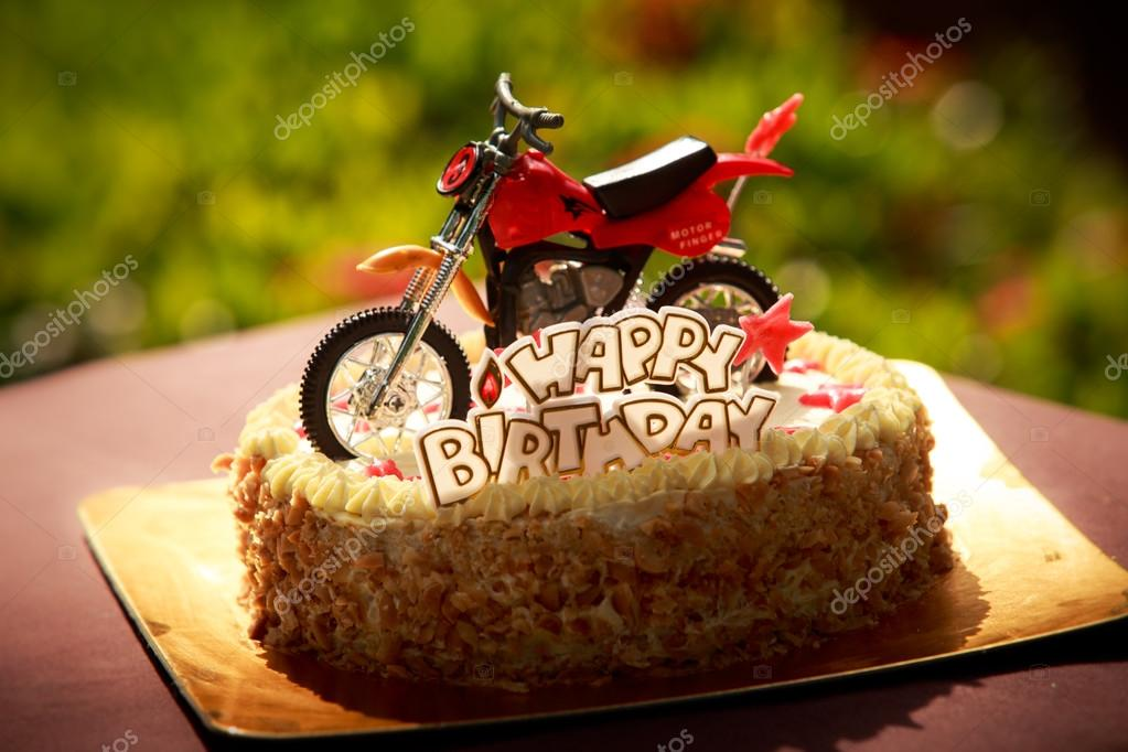 Birthday cake decorated with motorcycle and red stars Stock