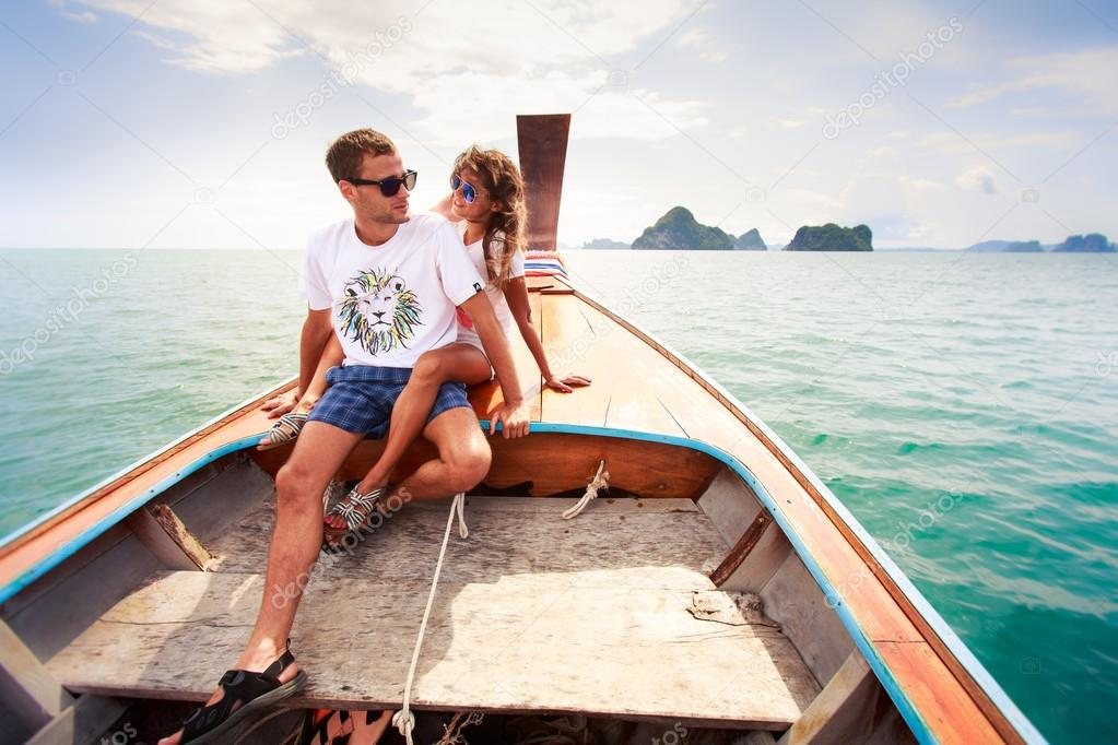Girl with boyfriend on longtail boat