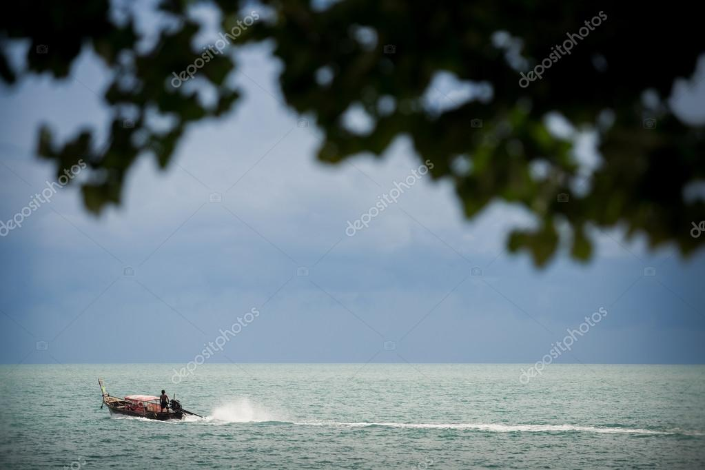 Longtail boat in tranquil sea