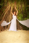 Bride in posing on beach