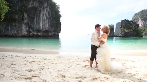 Bride in dress and handsome groom on island