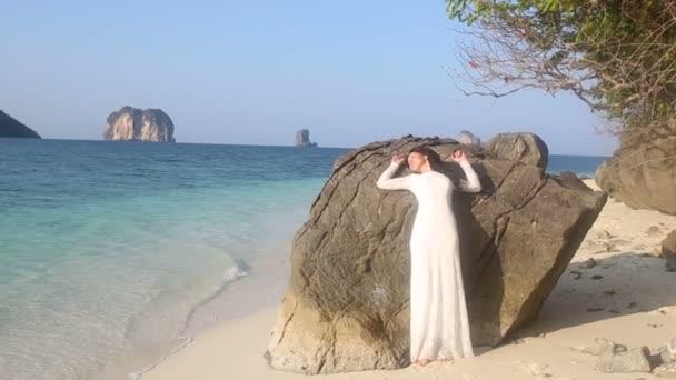 brunette bride  at sand beach