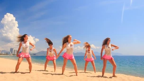 happy cheerleaders on beach