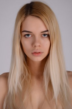 Close-up face portrait of young woman without make-up. Natural i