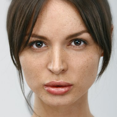 Portrait of young woman without make-up.