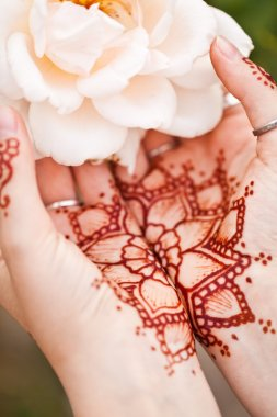 Mehndi tattoo. Woman Hands with black henna tattoos. India natio