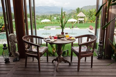 Healthy yummy breakfast with a beautiful view. Bali hotel. Morning mood