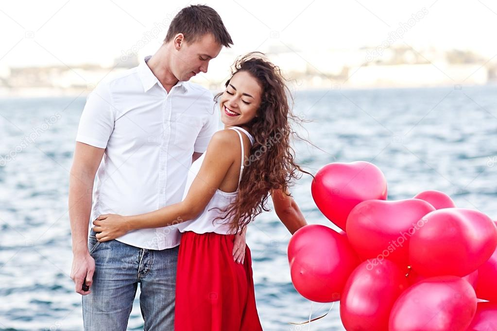 Teenage Couple Holding Red Baloons Hearts Valentine Day Stock