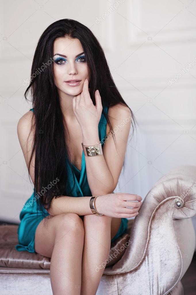 cute brunette woman in gorgeous emerald dress. — stock photo