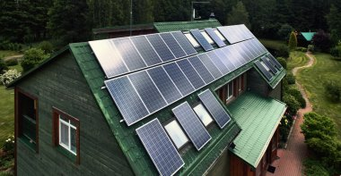 Rustic wooden house with a solar panels