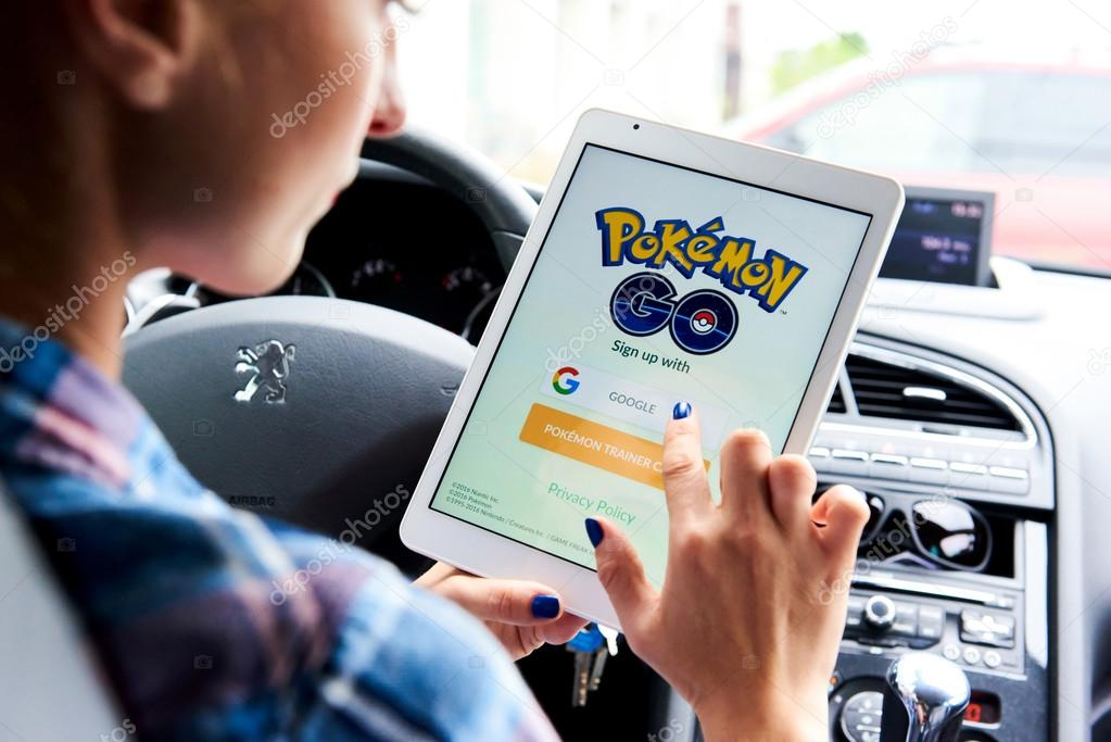 Woman playing a Pokemon Go game