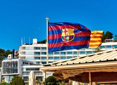 Waving flag of FC Barcelona. Tossa de Mar town. Catalonia, Spain