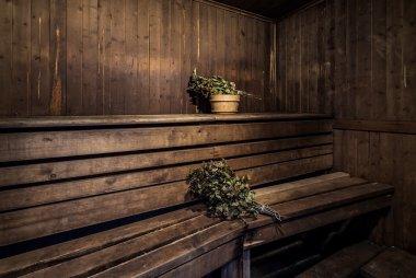Oak brooms inside of a bath house