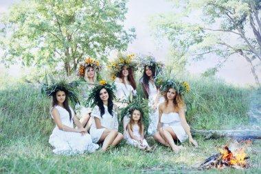seven beautiful girls in wreaths